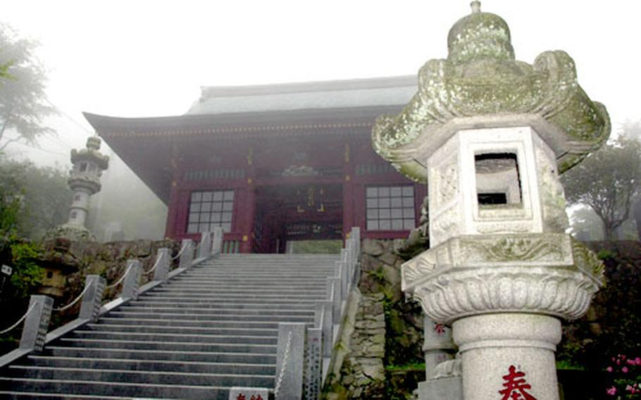 Not quite to the top yet, you pass through a shrine gate which leads to more stairs.