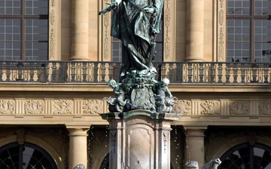 The Franconia Fountain in front of the west facade of the Residenz in Würzburg.