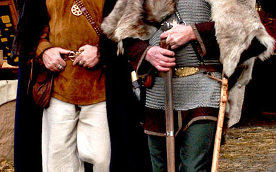Two warriors walk through the market at Ronneburg castle. Most of the vendors and many of the visitors are fans of medieval life, and dress true to the fashion of the time.