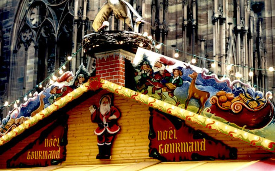 Strasbourg's cathedral provides a backdrop for the top of a decorated stall at the French town's Christmas market.