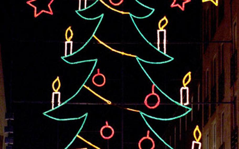 Seasonal decorations on a Liège shopping street.