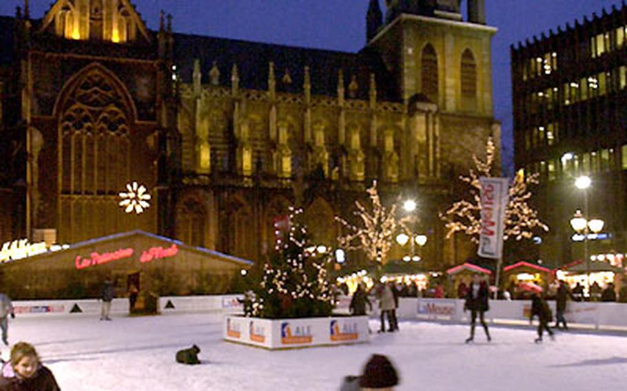 A child skates near the Liège cathedral.