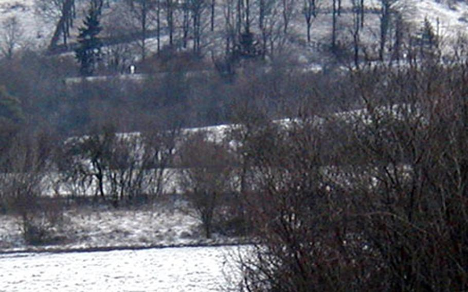 As a memorial to German soldiers killed in World War I, several veterans from the German village of Burgbernheim planted oak trees and bound them with vines to form this Maltese cross, a traditional Prussian military symbol. Eighty years later, it still stands, though it is hard to see without a blanket of snow on the hillside.