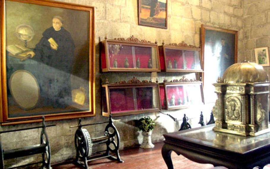 Religious paintings and artifacts give you a glimpse in the past at the St. Augustin church.