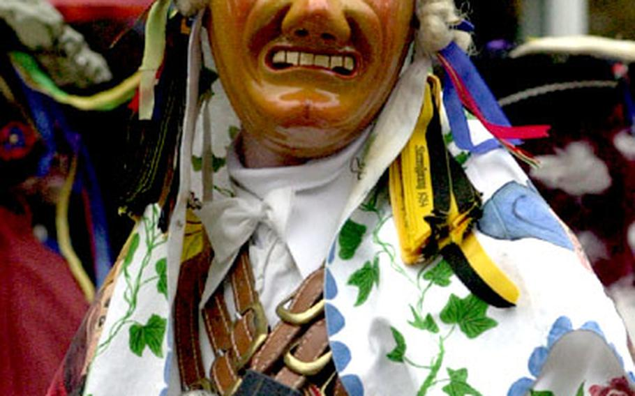 """A """"Biss,"""" a charachter of the Rottweil, Germany, Carnival marches through the streets of the town during the Rose Monday """"Narrensprung"""" (fools' jump)."""