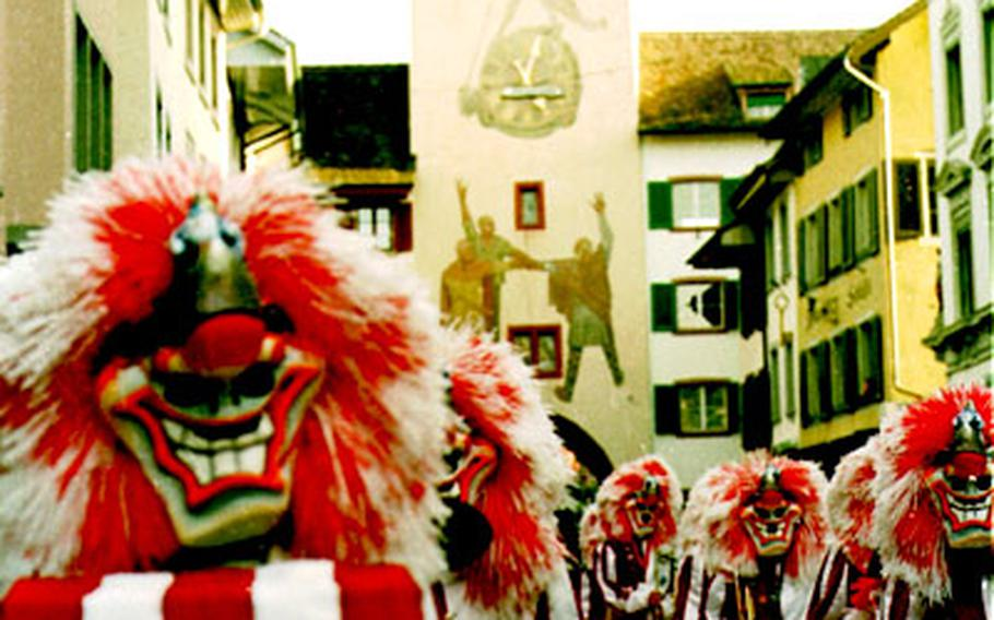 """A Fasnacht parade with drummers and pipers takes place in Liestal before the """"Chienbäse,"""" the traditional fire parade that starts at 7 p.m."""