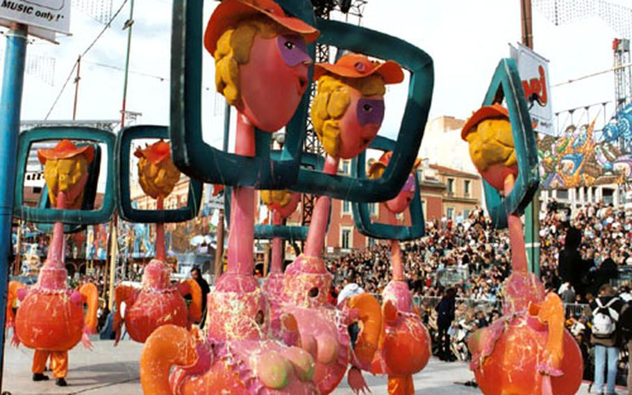 """Television """"talking heads"""" roam the streets of Nice, France, during Carnival celebrations last year. Political cartoonists from throughout the world submit sketches of floats to be considered, and local artists create the final products."""