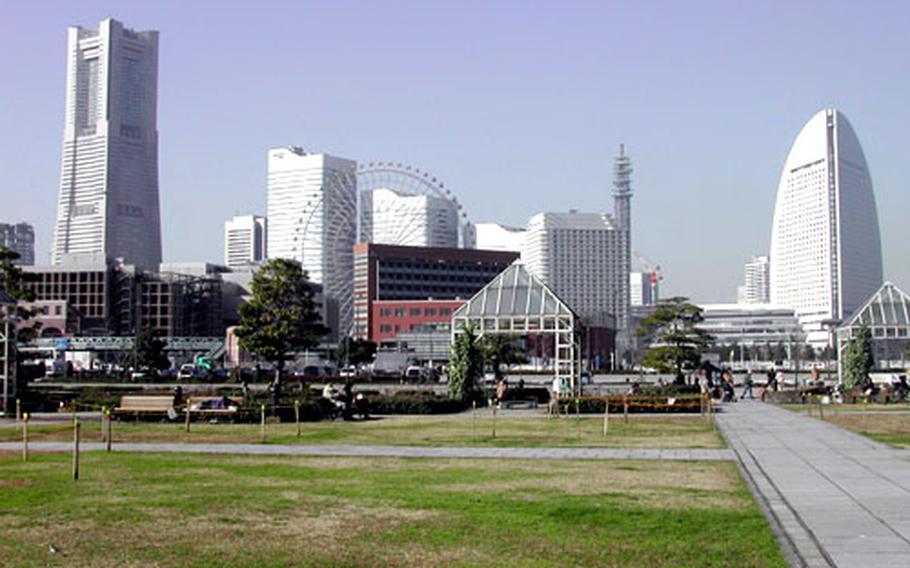 The skyline of Minato Mirai 21, from left: Yokohama Landmark Tower, Queen's Square Yokohama buildings, the ferris wheel and Yokohama Grand Intercontinental Hotel.