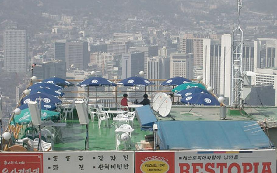 At the top of Namsan, just above the cable car house, you can stop and enjoy a snack and the view of downtown Seoul.