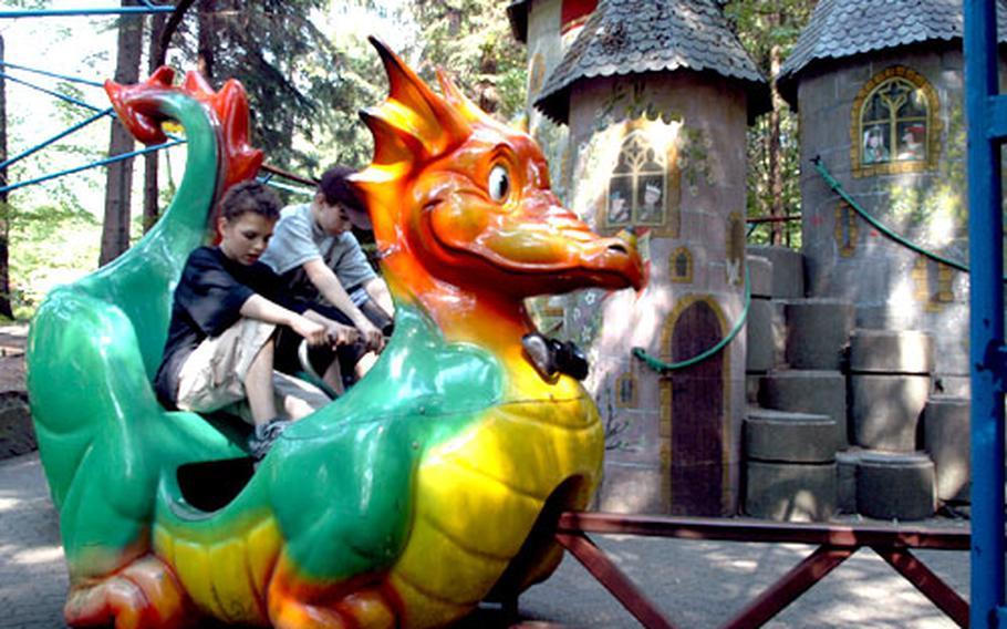 Kids peddle the magic dragon around the castle at the Märchen Paradies.
