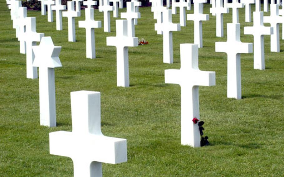 A lone rose pays final tribute to a fallen soldier at the Normandy American Cemetery in St. Laurent, France.