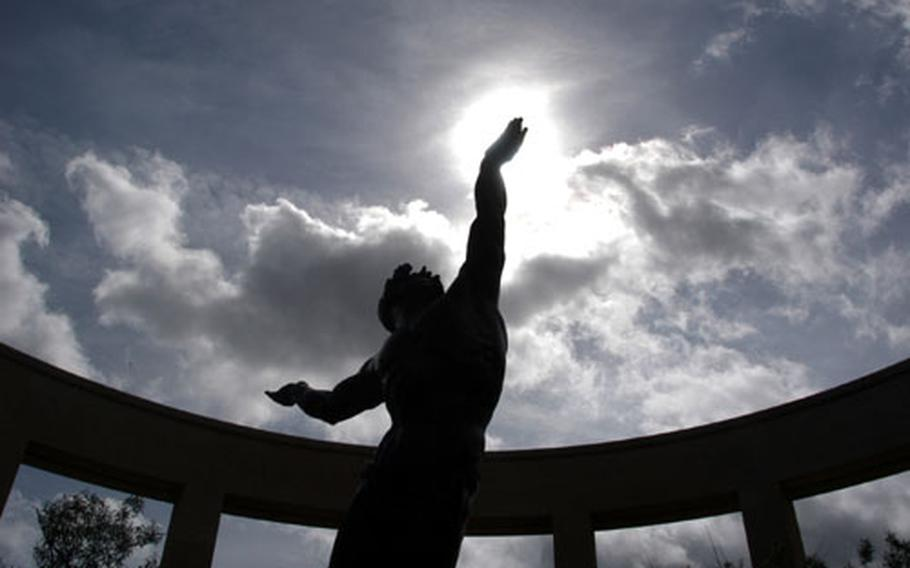"""""""The Spirit of American Youth Rising From the Waves"""" is an impressive bronze statue at the American cemetery at Omaha Beach."""