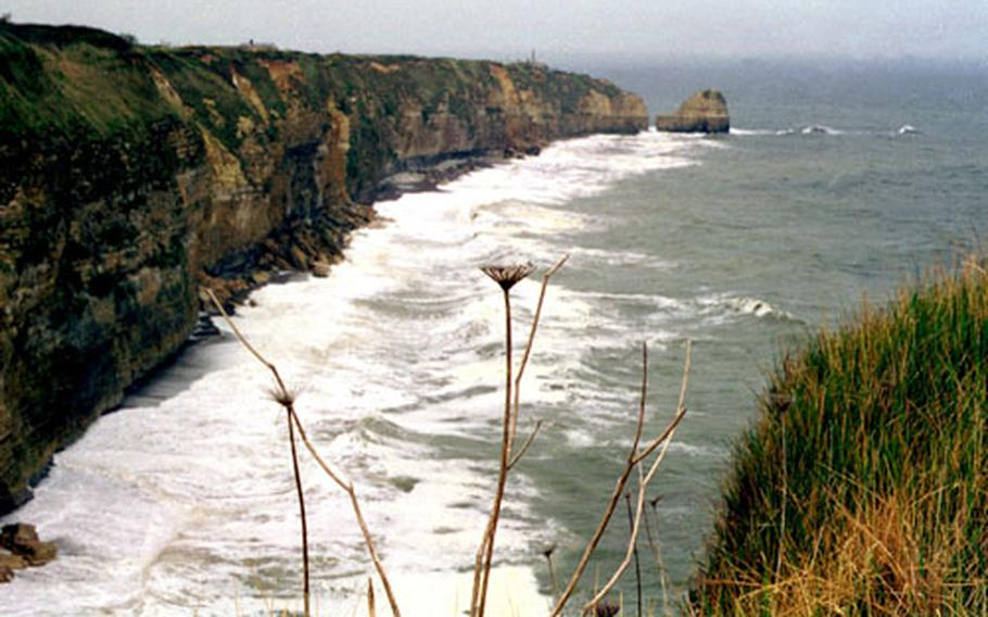 Heavy waves batter the cliffs of Pointe du Hoc, in Normandy, France. The cliffs were taken at low tide by U.S. Rangers on D-Day, 60 years ago.