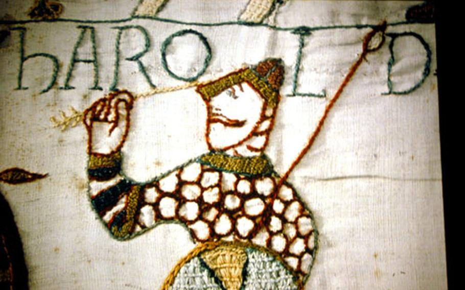 Detail of a portion of the 230-foot-long Bayeux tapestry shows the moment of the death of King Harold in the Battle of Hastings in 1002.