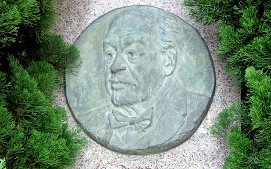 A monument honoring Dr. Langdon Warner at the west exit of Japan Rail's Kamakura Station.