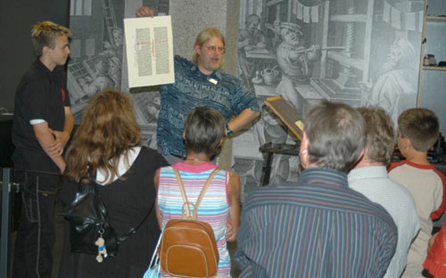 A tour guide shows a page he made in a printing press like the one Johannes Gutenberg used in the 15th century to advance printing techniques. Gutenberg's workshop is recreated in the Gutenberg Museum in Mainz.