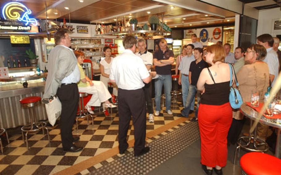 Many groups and organizations use the conference rooms available at Fahr Werk for business sessions before blowing off some steam on the racetrack. Fahr Werk management encourages troops to use the conference rooms for sergeant's time training and then the track for organization or activity days. Here a group of German workers gathers in the American diner just before the race.