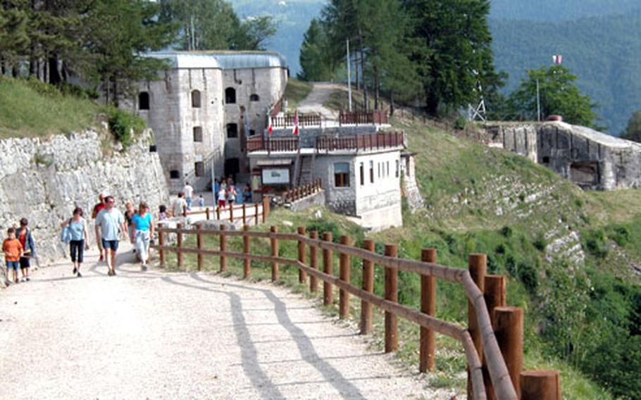 An old military road cut into a limestone spur leads to Forte Belvedere, whose casemate rises from the hillside.