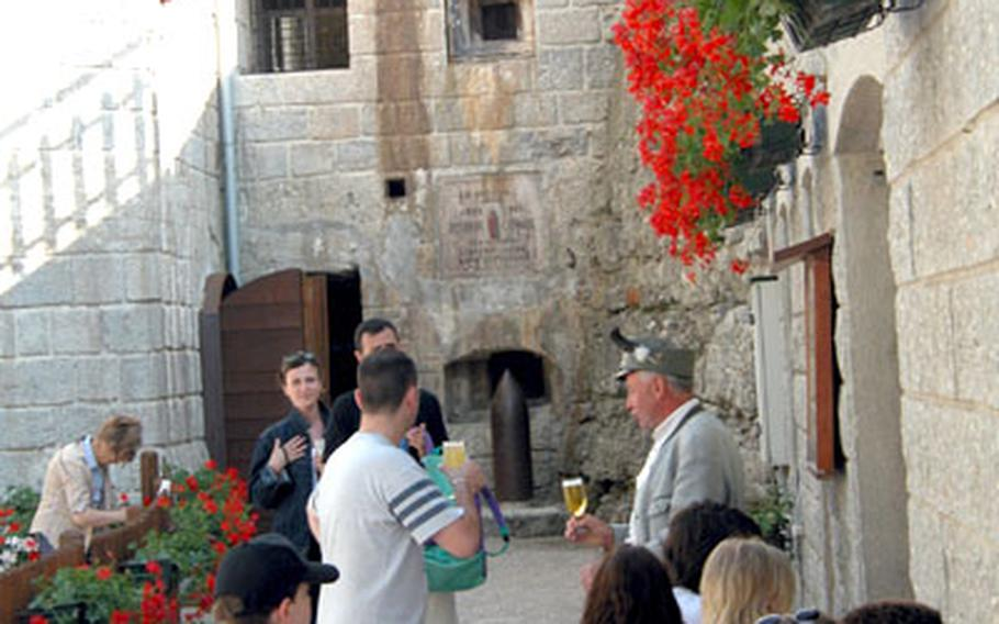 Tourists stand outside the snack bar near the casemate entrance at Forte Belvedere with guide Fabrizio Corradi.