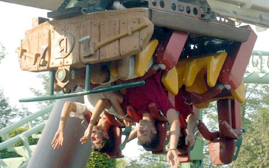 Reaching for the ground, not the sky, on Gardaland's Sequoia Adventure ride.