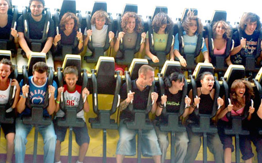 Happy customers on Gardaland's Top Spin.