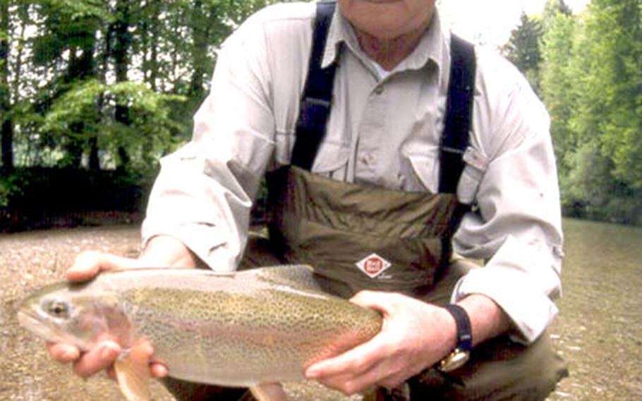 Larry Walks, a North Dakota native who nearly 30 years ago retired from the Army in Germany, shows off a big rainbow trout from the Deutsche Traun river.