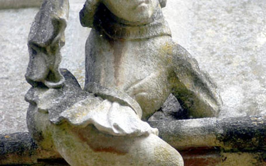 This figure of a boy climbing to the roof of St. Mary's Church is one of the delightful details to be found at the church.