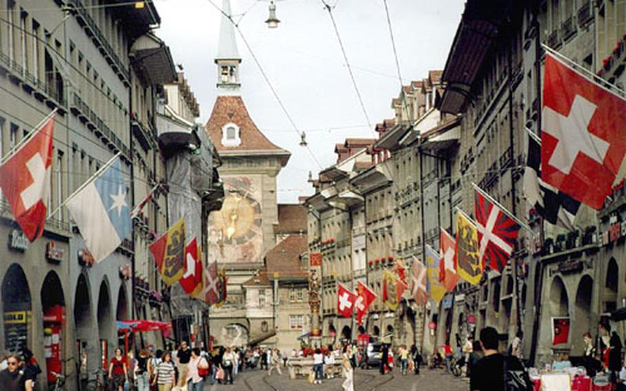 Colorful flags flutter above the arcades on the Kramgasse in the heart of Bern, adding a festive flair to the city.