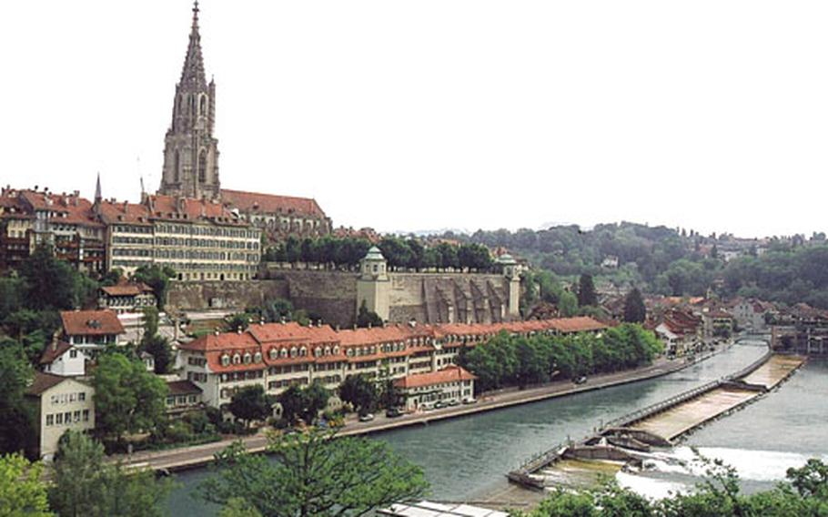 The steeple of Bern's cathedral towers over the city's red-tile rooftops.