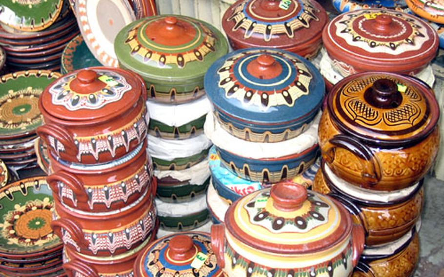 Colorful pottery, a hallmark of Bulgarian handiwork, is stacked up for sale at an open-air market in Sofia.