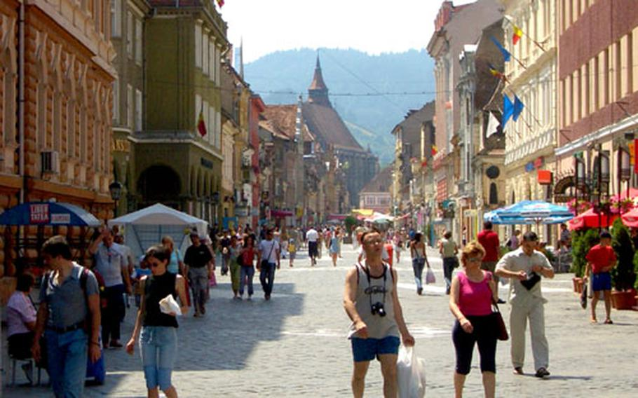 The main pedestrian street in Brasov features an Old World atmosphere.