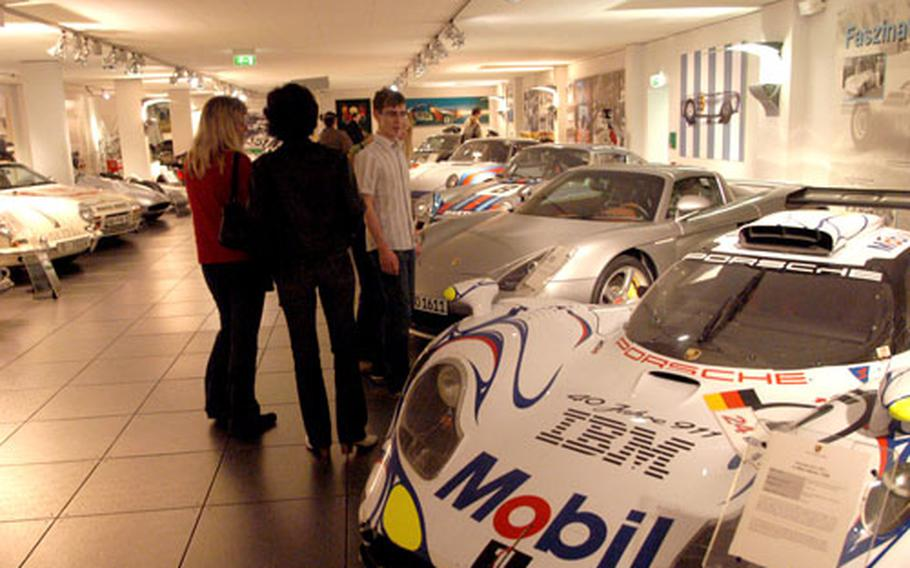 Race cars and street cars sit side by side at the museum.