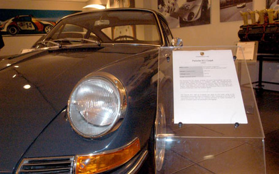 """Placards like this one tell visitors to museum that the 1964 911 Coupe was the first in the legendary """"911"""" series."""