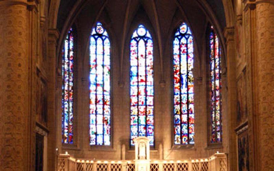 Inside the Cathedral of Our Lady of Luxembourg. The rear part of the cathedral dates back to the beginning of the 17th century; the front part, including the choir with its stained-glass window, was built between 1935 and -38.