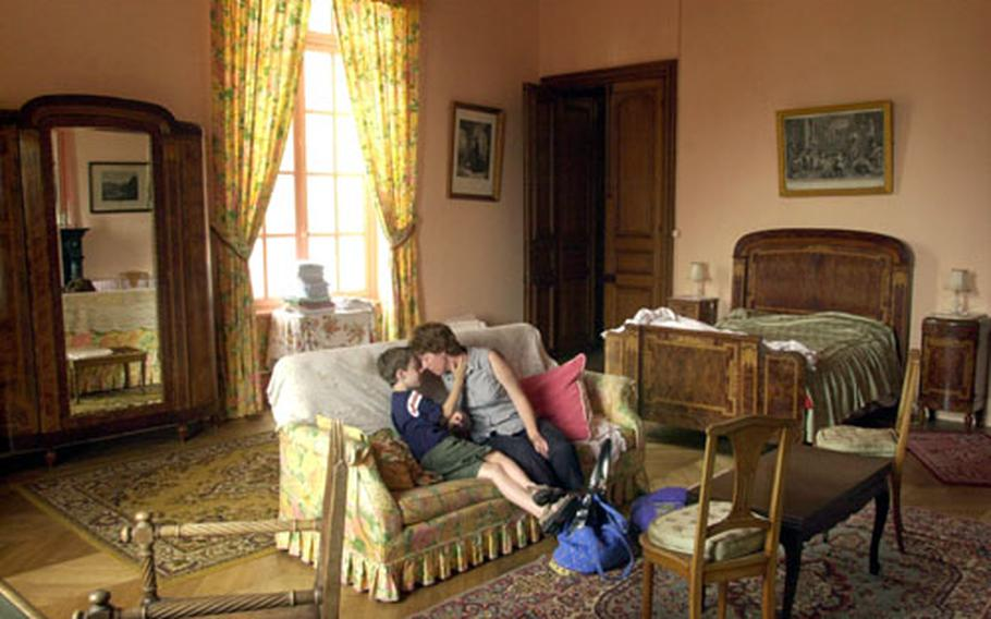 For the cost of a Red Roof Inn, you can get a cavernous room at a real chateau in Villersexel near Mulhouse. Dr. Chris Bryant, an American pediatrician and epidemiologist, shares a moment with her son, Jefferson.