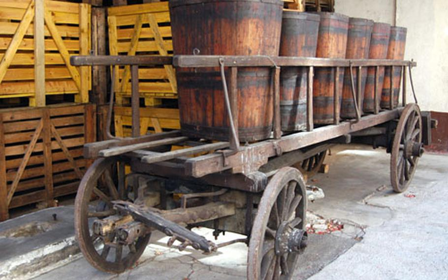 An old cart filled with barrels used to bring grapes down from the harvest stands in a winery in Ribeauvillé.