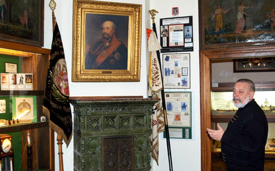 Custodian Herbert Rest of the Blücher museum in Kaub, Germany, explains a part of the collection of memorabilia of Field Marshal Gebhard Leberecht von Blücher.