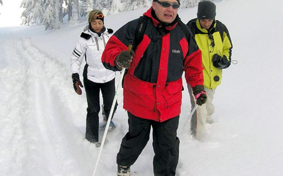 Jan Brezina, front, a Czech member of the European Parliament, enjoys snowshoeing on trails a the Cervenohorské sedlo resort.