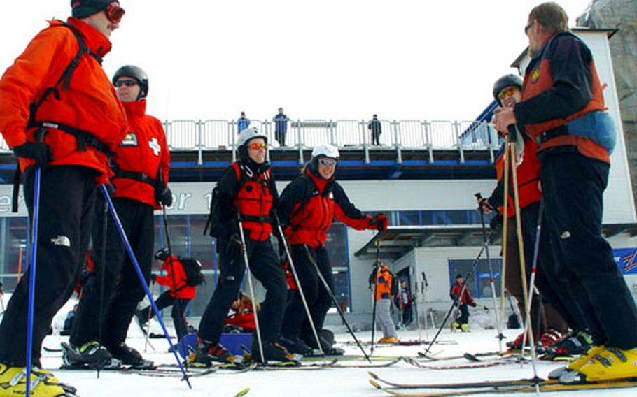 Members of the National Ski Patrol prepare to review ski and sled skills during an instructor's course at the Hintertux glacier in Austria earlier this month. They are, from left, Tom Haake, Steve Briggs, Michaela Saeftel, Stella Reuter, Tom Saxen and Al Prucnal.
