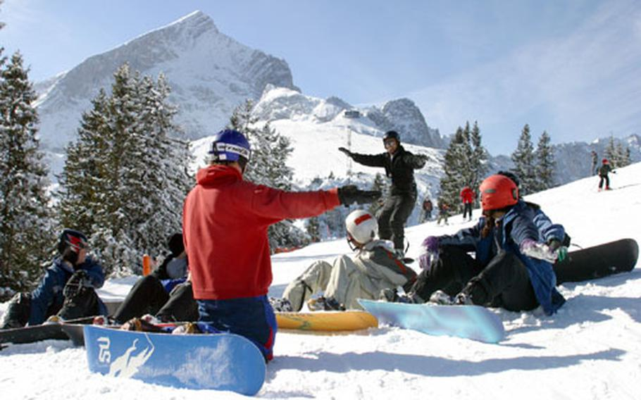 Students learn the basics of snowboarding from Mike Ensor, an Edelweiss Resort instructor, at the Hausberg Ski Area in Garmisch.