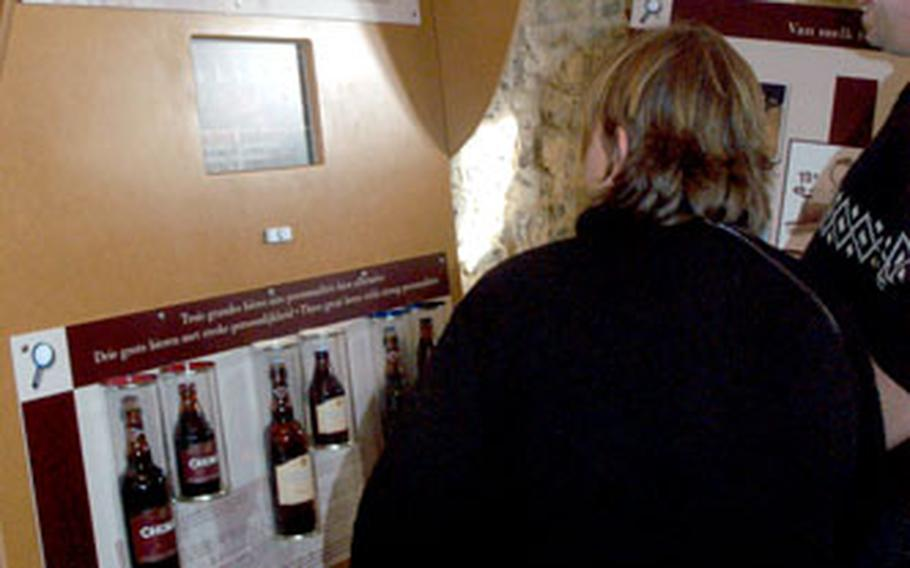 Visitors to the Chimay beer exhibit watch a video on how the brew is made. The monks make three beers, including Chimay Blue, a strong beer that is 9 percent alcohol.