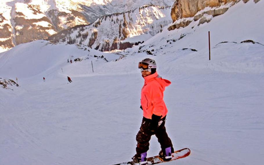 The writer, happily upright on a snowboard, showing any onlooking teenagers how it's done.