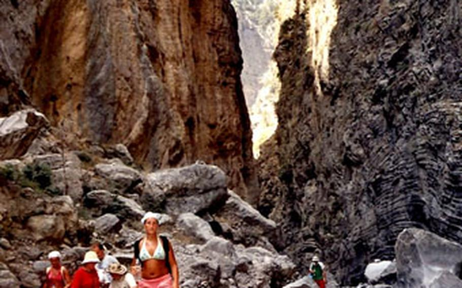 The narrowest part of the Samaria Gorge is known as the Iron Gates, about seven miles from the trail head. At this point, the towering walls of the Samaria Gorge narrows to no more than 13 feet.