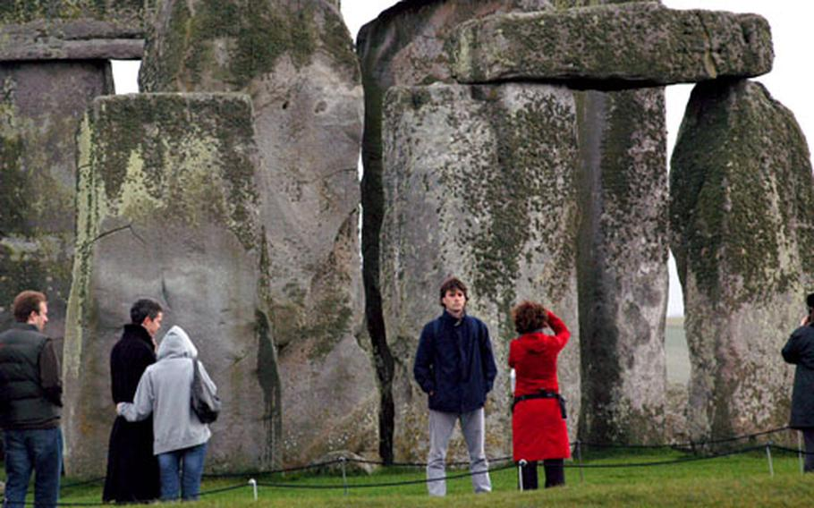 Visitors to ancient Stonehenge, built in three phases starting over 5,000 years ago, grab some photos and a close look at the massive standing stones.