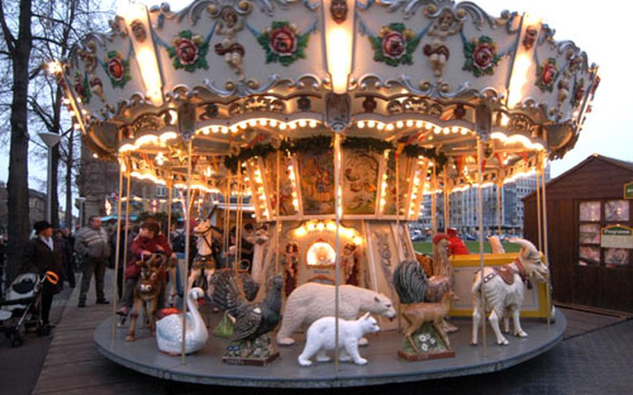 There are rides for the kids at the Christmas market in Mannheim, as there are at most Christmas markets in Germany.