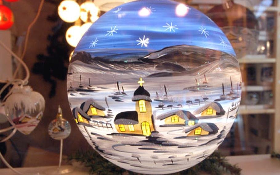 A beautiful hand-painted glass Christmas tree bulb on sale at the Christmas market in Mannheim.