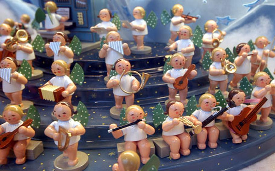 An angel orchestra on sale at the Mannheim, Germany Christmas market.