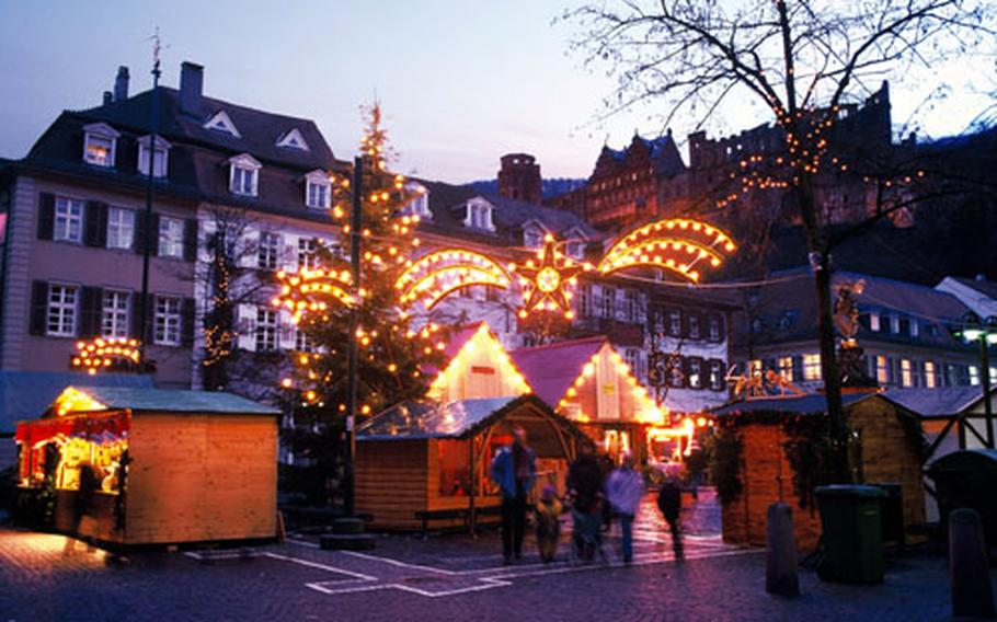 The Kornmarkt features several traditional exhibits and booths. At back right is Heidelberg Castle, which this year will host a huge Advent calendar.