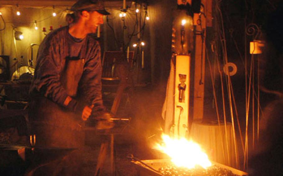 A blacksmith creates an ornament at last year's Christmas market in the palace courtyard.