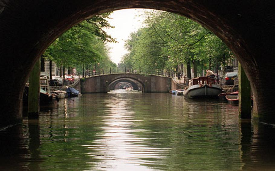 Amsterdam is a city of canals, boats and bridges.